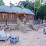Flagstone patio and outdoor space with furniture